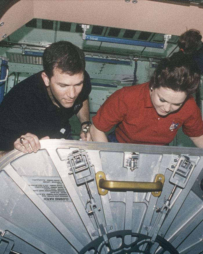 STS-96 Astronauts Adjust ISS Unity Hatch