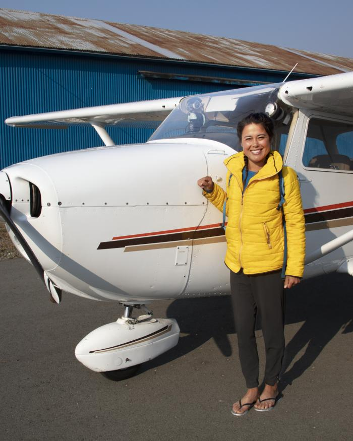 Ariel Tweto in front of plane