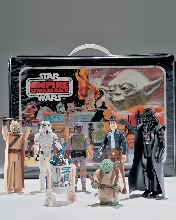 A set of Star Wars toys manufactured for the release of The Empire Strikes Back, 1980. Pictured are R2-D2, Han Solo, Darth Vader, Yoda, Boba Fett, and a Storm Trooper, among others.