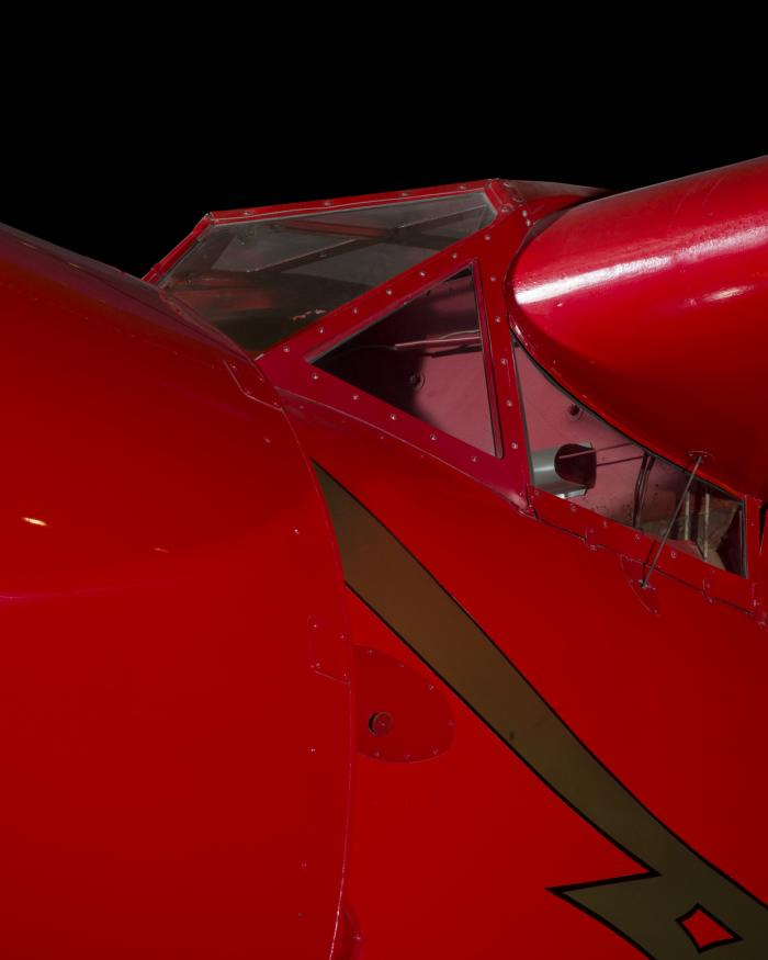Outside of cockpit of red Amelia Earhart Lockheed Vega 5B aircraft