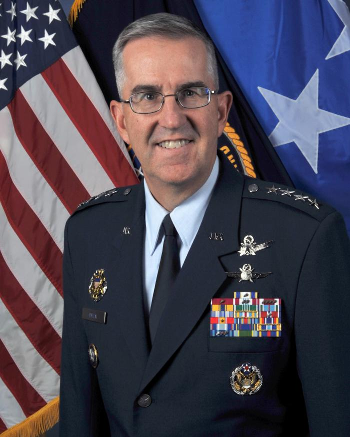 Portrait of Gen. John E. Hyten in front of American flag