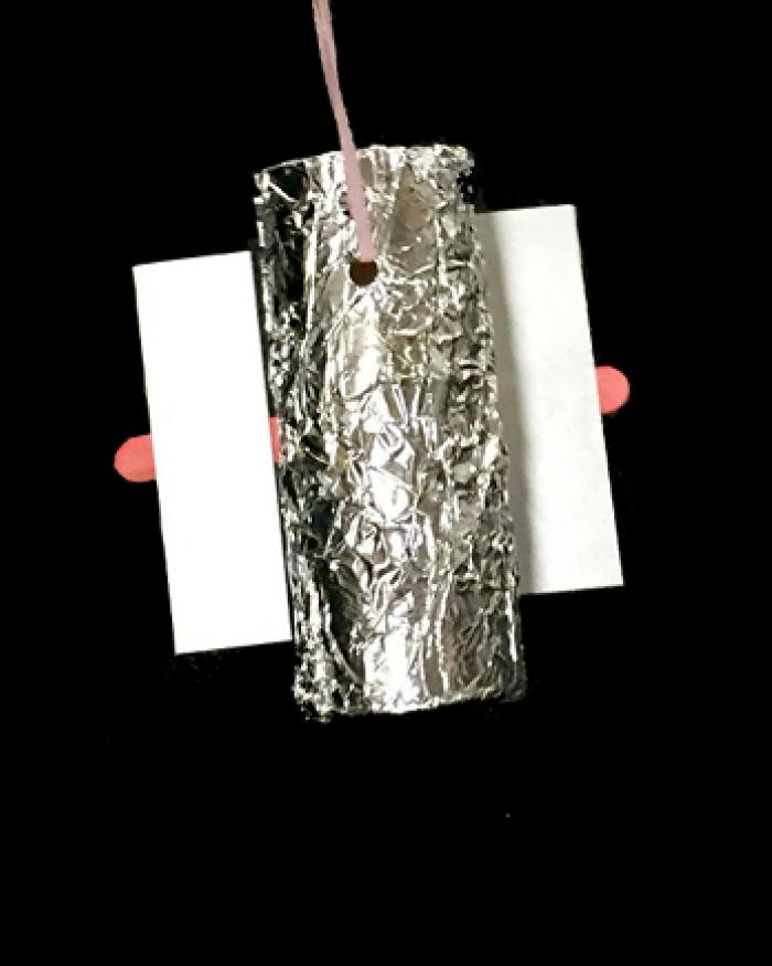 A miniature version of the Hubble Telescope made out of a toilet paper roll.