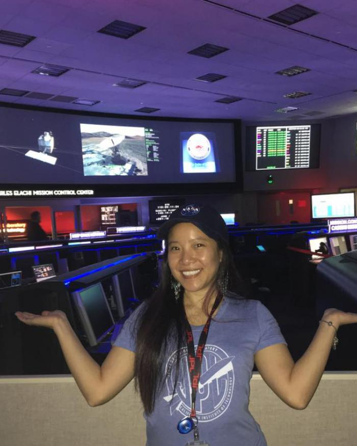 Programmer Melody Ho standing inside mission control at the NASA Jet Propulsion Lab