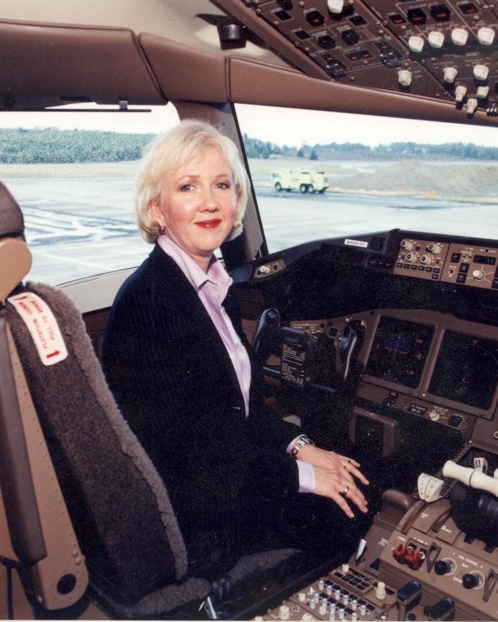 Suzanna Darcy-Hennemann in the cockpit of a plane.