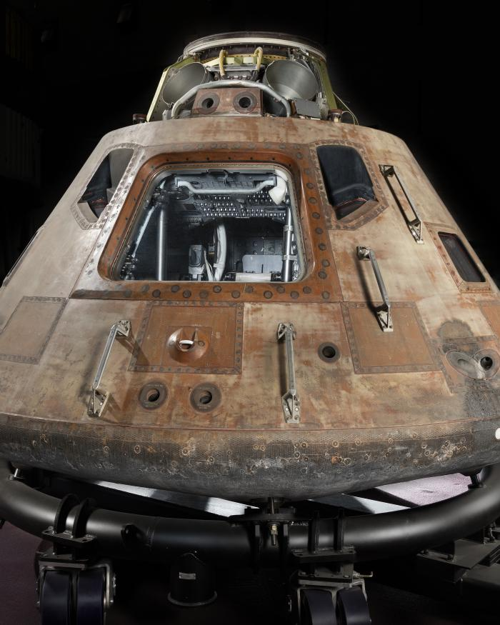 Picture of Apollo 11 Command Module on display.