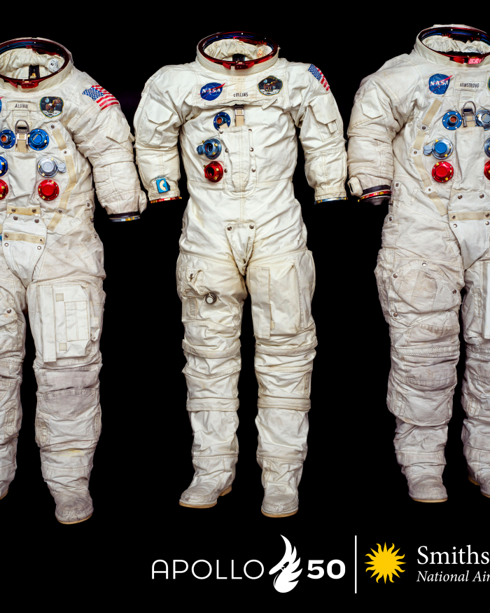 three white Apollo spacesuits