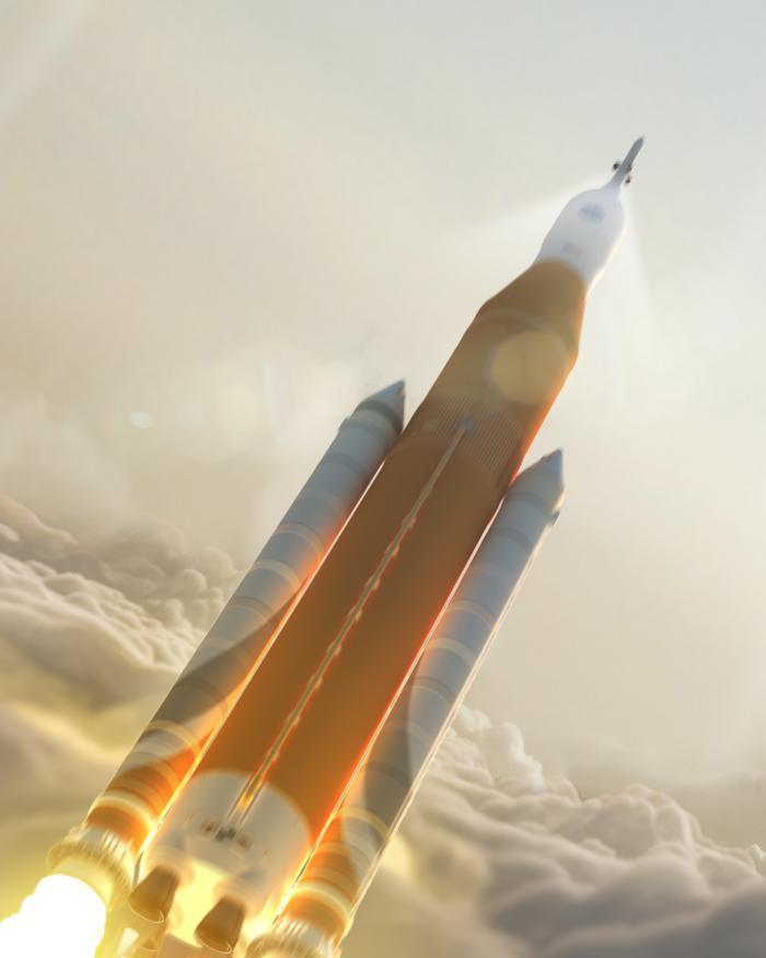 Artist rendering of SLS rocket at launch in the clouds.