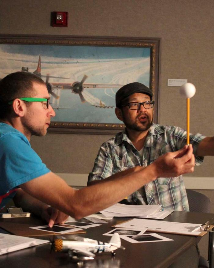 Two middle school science teachers explore a Moon phase activity during the STEM Institute for Educators at the Museum in 2016