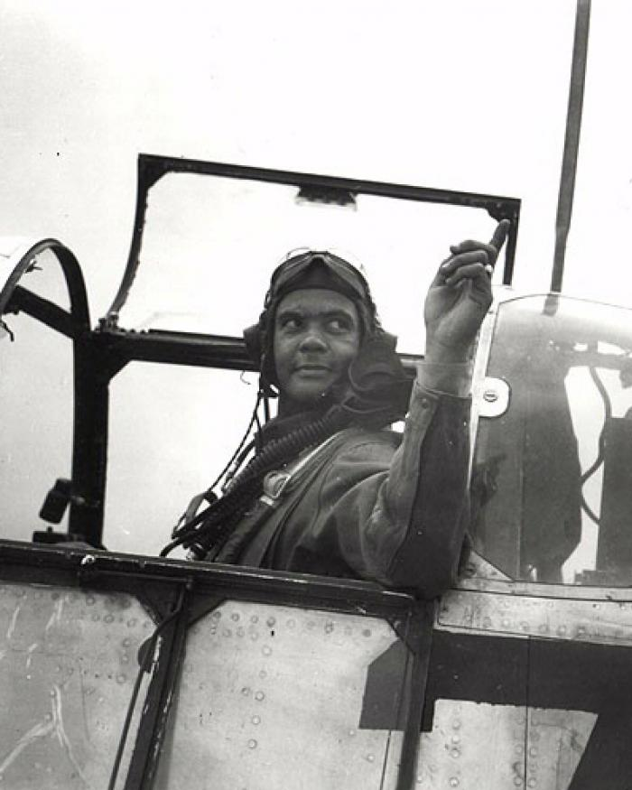 A black and white photograph of a pilot.