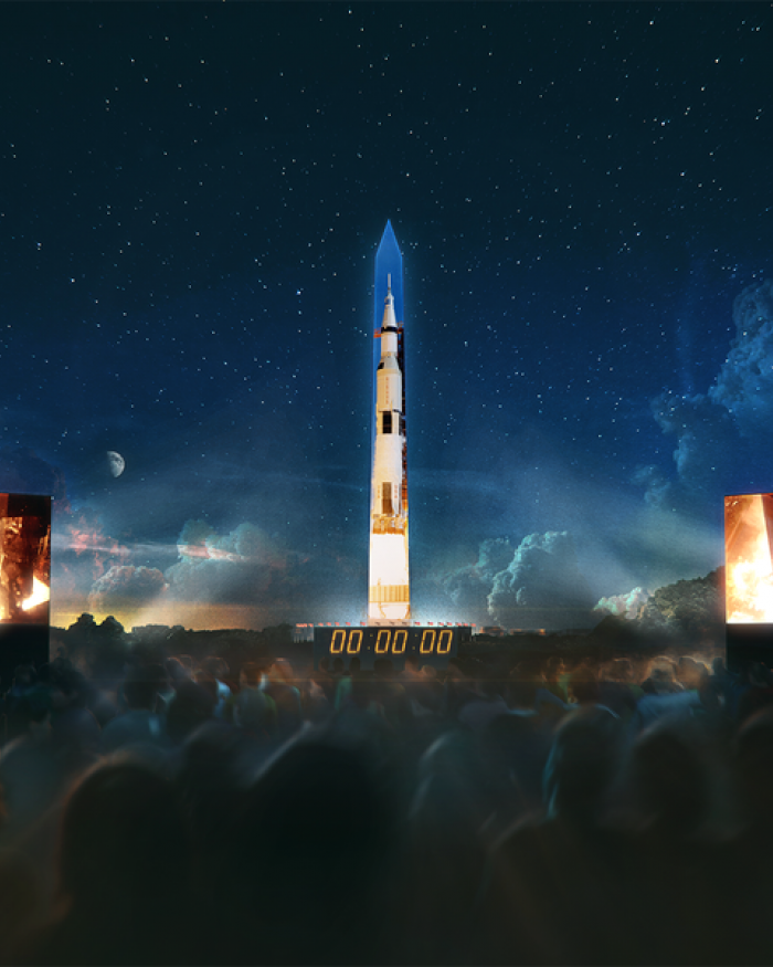 Projection of Saturn 5 rocket on Washington Memorial