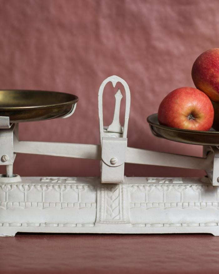 Photo of apples sitting on a scale