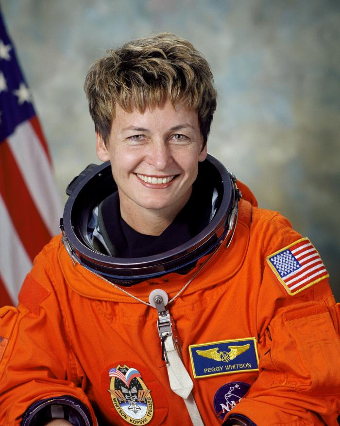 Astronaut portrait in orange flight suit