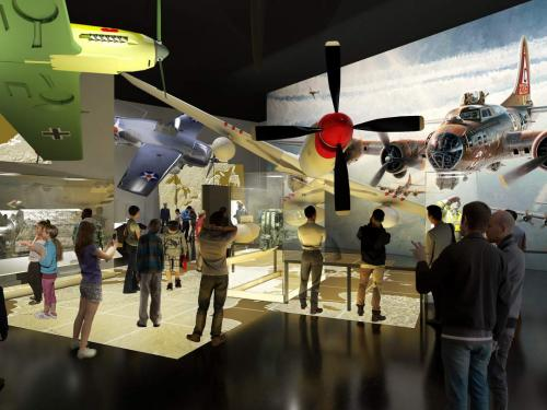 Severna airplanes hang suspended from the ceiling as visitors look on.