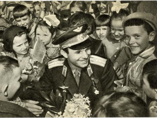 Soviet cosmonaut Yuri Gagarin surrounded by a crowd of children