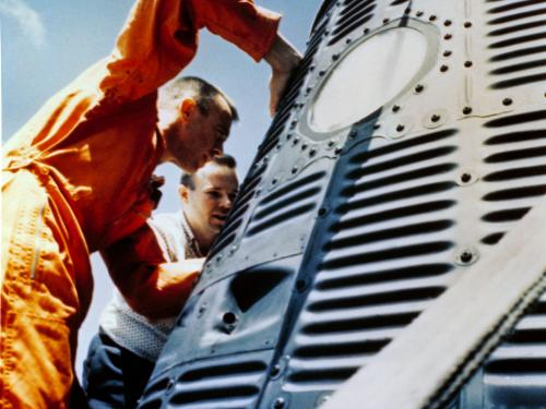 Alan Shepard looking into the Freedom 7 capsule