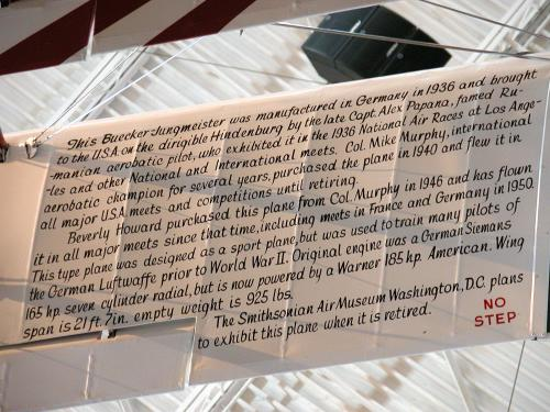 Text written on wing of plane describing plane's history.