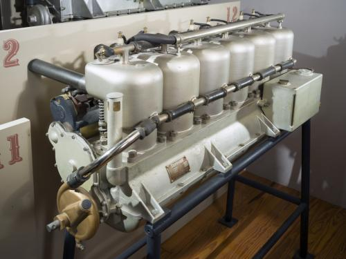Six-cylinder long engine on display stand in museum