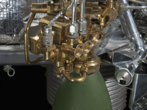 Green painted engine attached to a spacecraft.