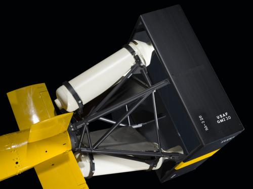 Dual rocket motors attached to the body of a missile.