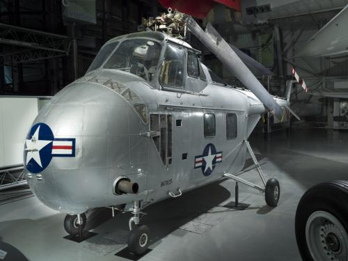 Silver painted helicopter. View is from the front of the helicopter.