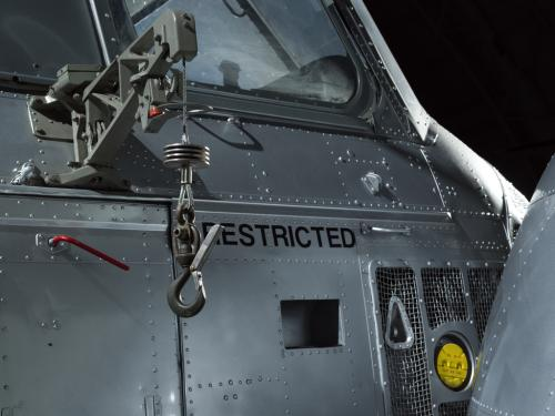 Close up of an oil cap and cargo hook of a helicopter.