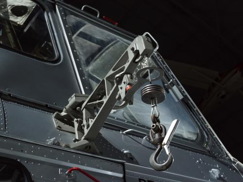 View of a cargo hook attached to a helicopter.