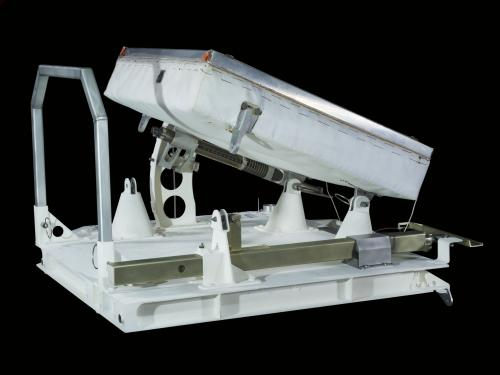 Side view of a white pallet with raised 100 lens laser reflector, training unit, Apollo 11.
