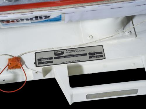 Label attached to a Retro-Reflector Bendix Aerospace Systems Division is printed on the label.