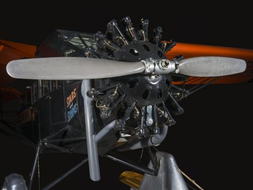 Close up image of a propeller and engine of an airplane.