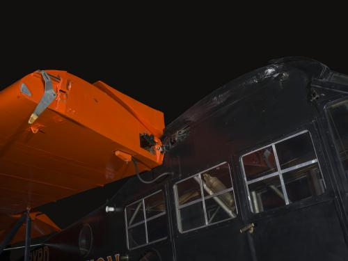 Orange wings and black painted fuselage of an airplane.