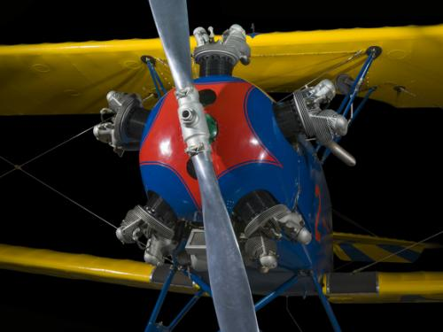 Propellers painted to a yellow and blue biplane.
