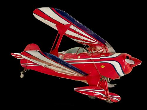 Red, white, and blue painted aerobatic biplane.