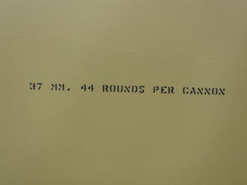 Painted on a green plane is 37 MM. 44 rounds per cannon