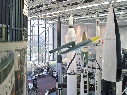 Several rockets are seen from above, looking down into the Space Race gallery.