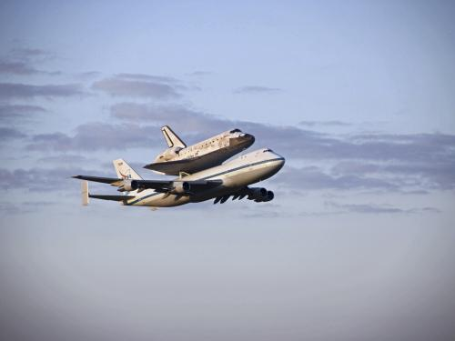 Space Shuttle Discovery Leaves Kennedy Space Center