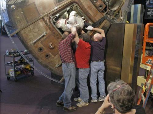 Collins Spacesuit Removal from Columbia