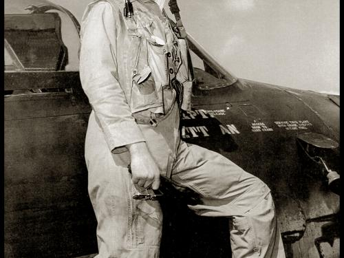 Bill Daniels standing on F8F wing