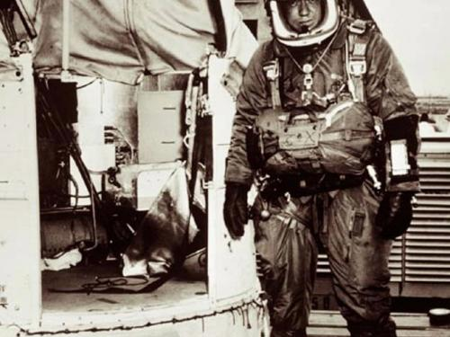 Joseph Kittinger suited and standing next to Excelsior gondola