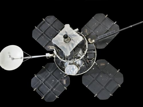 Lunar lander with four square solar panels attached to central instrument box and round satellite dish