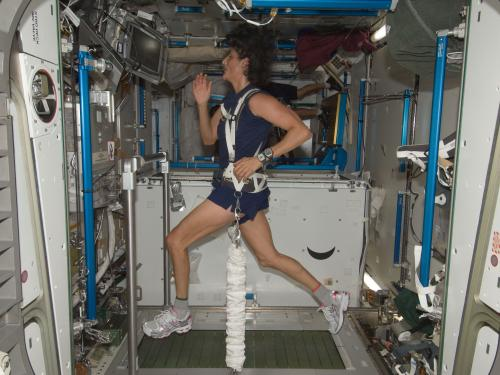 NASA astronaut Sunita Williams exercising on a treadmill aboard the International Space Station, 2012.
