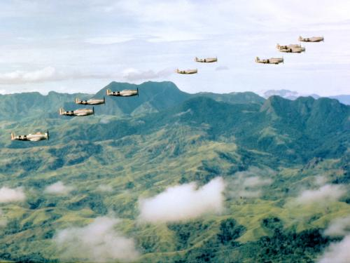 Mexican P-47 Thunderbolts fly over central Luzon in July 1945