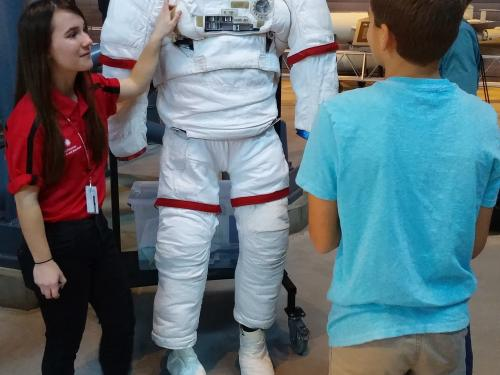 Explainer Demonstrates EMU Spacesuit