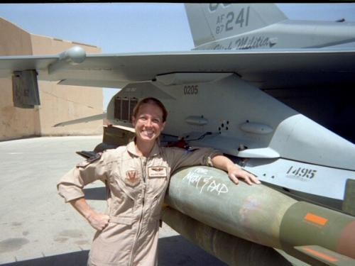 "Pilot Heather ""Lucky"" Penney in front of a plane."