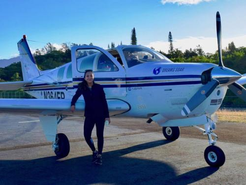 Shaesta Waiz in front of her Dreams Soar airplane.