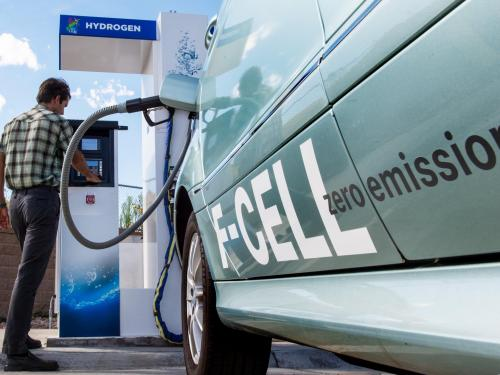 A fuel cell car being filled at a hydrogen pump.