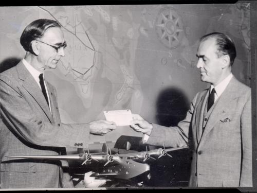 William J. Eck Accepts Ticket for First Pan American Transatlantic Flight