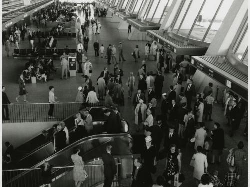 Travelers in the main departures terminal.