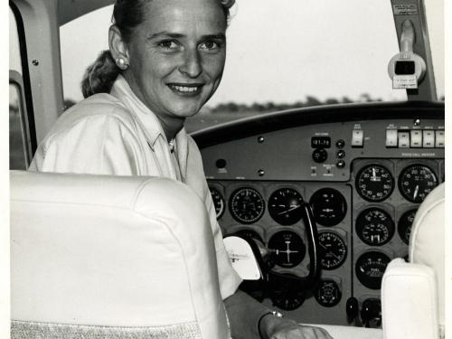 Woman in cockpit of aircraft