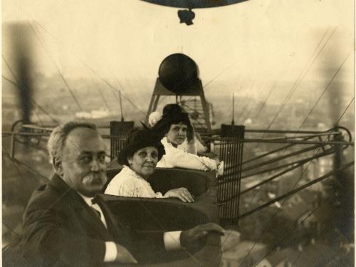 Three people sit in an airship