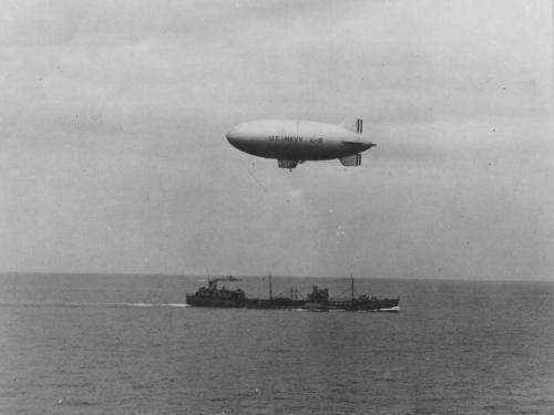 US Navy blimp L-8 in flight to drop off supplies